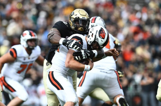 Oct 27, 2018; Boulder, CO, USA; Colorado Buffaloes defensive end Terrance Lang (54) sacks Oregon State Beavers quarterback Jack Colletto (12) in the first quarter at Folsom Field. Mandatory Credit: Ron Chenoy-USA TODAY Sports