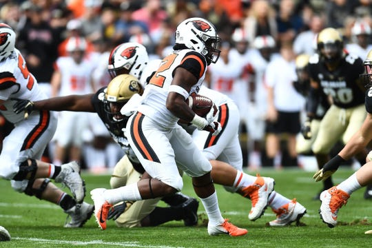Oct 27, 2018; Boulder, CO, USA; Oregon State running back Jermar Jefferson carries the ball in the first quarter against the Colorado at Folsom Field. Mandatory Credit: Ron Chenoy-USA TODAY Sports