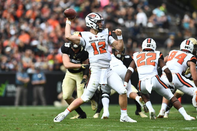 Oct 27, 2018; Boulder, CO, USA; Oregon State Beavers quarterback Jack Colletto (12) passes in the first quarter against the Colorado Buffaloes at Folsom Field. Mandatory Credit: Ron Chenoy-USA TODAY Sports