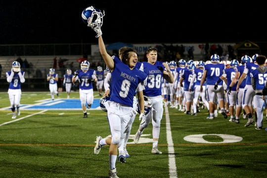 McNary's Griffin Oliveira (9) celebrates after McNary's 40-33 win over South Salem at McNary High School on Friday, Oct. 26 in Keizer.