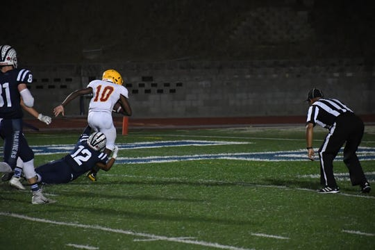 Palma wide receiver Jon Jon Berring (10) scores his second touchdown of the game.