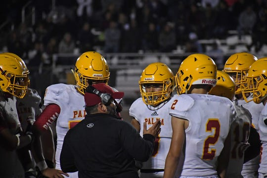 The Palma defense huddles up before the end of the game.