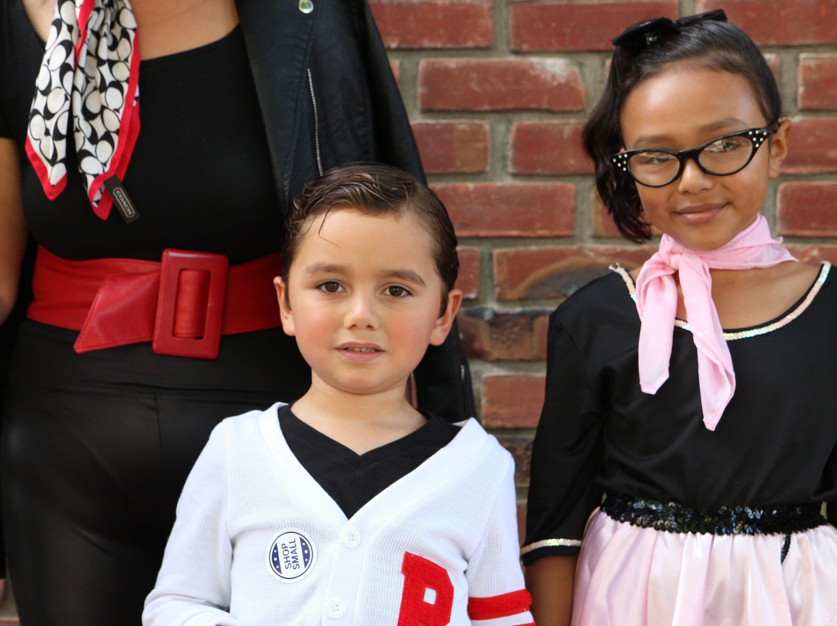 "Nicholas and Savinah Celaya Vazquez show off their ""fifties"" costumes Saturday in Oldtown."