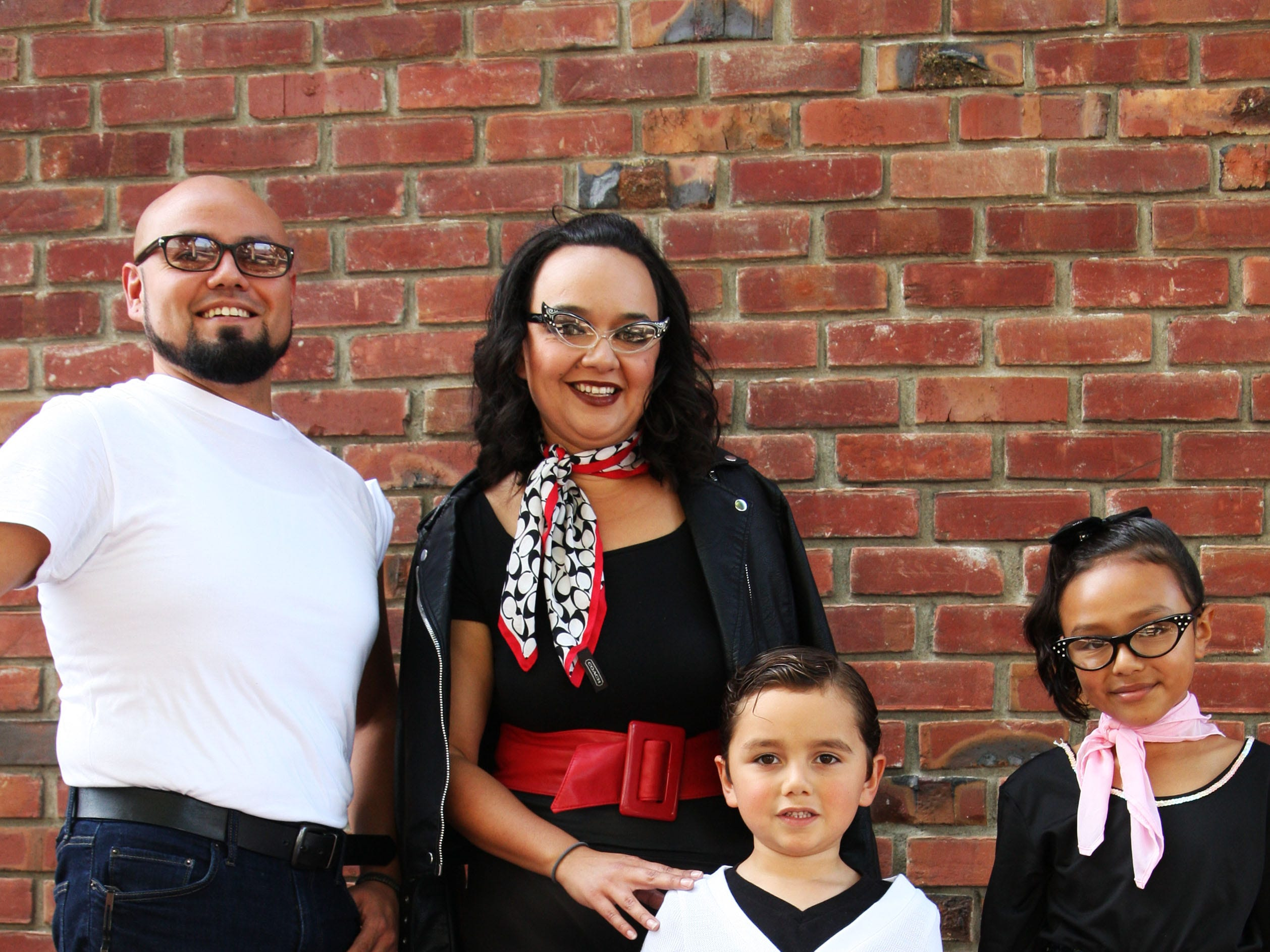 """The Celaya Vazquez family (Alfredo and Jackie with their children Savinah, Nicholas and Tadeo) go Trick-or-Treating in Oldtown Salinas Saturday. According to Nicholas, they are dressed as """"the fifties!"""""""