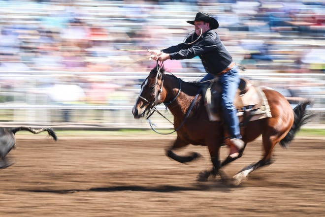 Blake Ash rides out in calf roping during Cinch Roping Fiesta Saturday, Oct. 27, 2018, at the Outdoor Roping Arena.
