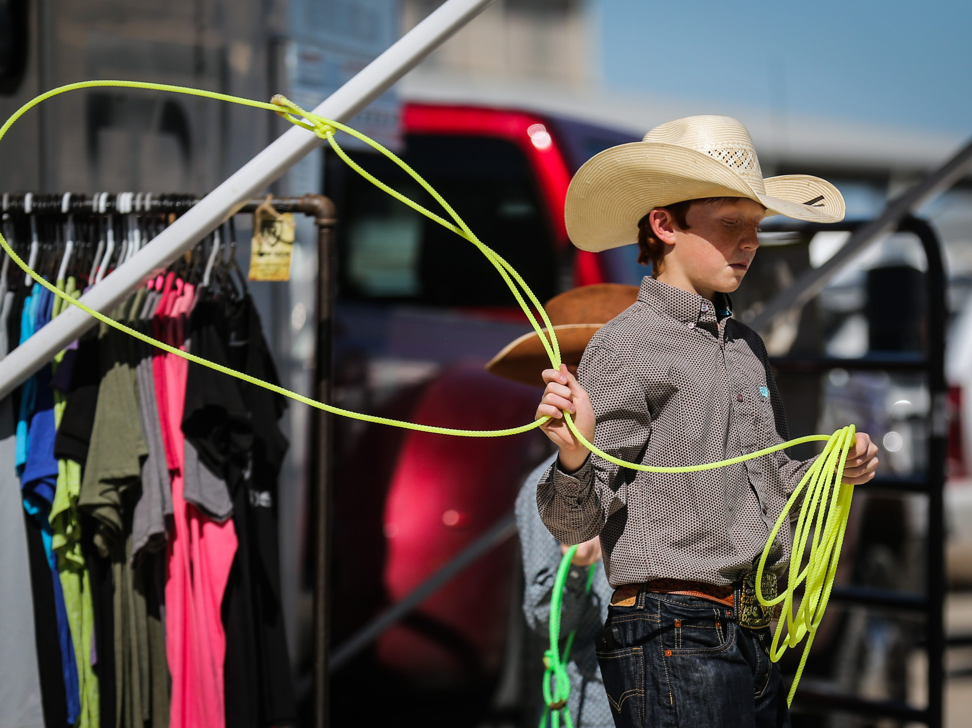 Casey Miller, 12, practices with his rope Saturday, Oct. 27, 2018, during Cinch Roping Fiesta.