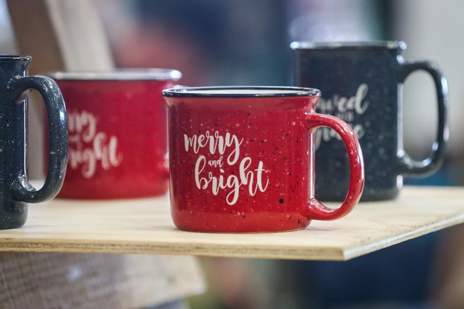 Mugs for sale at the 2018 Cowboy Christmas Gift Show.