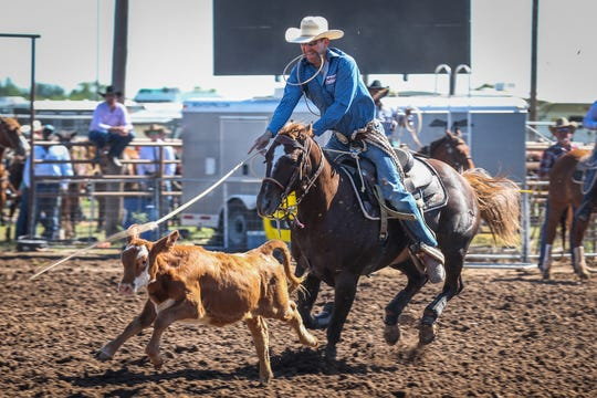 Seth Cooke rides out to tie down a calf during Cinch Roping Fiesta Saturday, Oct. 27, 2018, at the Outdoor Roping Arena.
