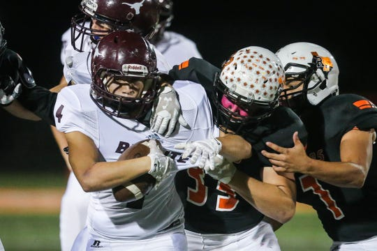 Robert Lee's Bryce Raynor tackles Bronte ball carrier Riley McIntire Friday, Oct. 26, 2018, in Robert Lee.