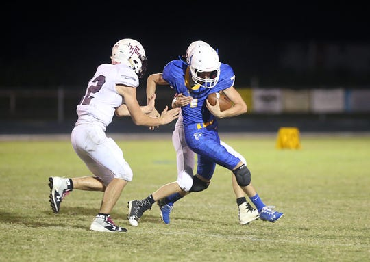 Veribest's Chad Holik is tackled Friday, Oct. 26, 2018 by Veribest's players.