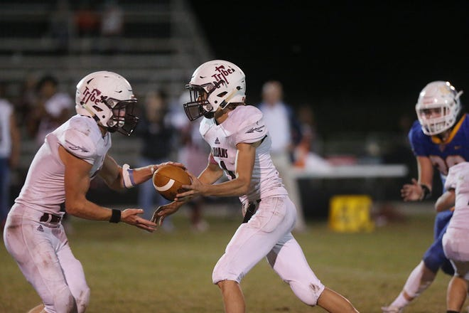 Paint Rock's Casey Grant (#1) passes off the ball Friday, Oct. 26, 2018 to teammate Travis Bowen (#5) during their game against Veribest.
