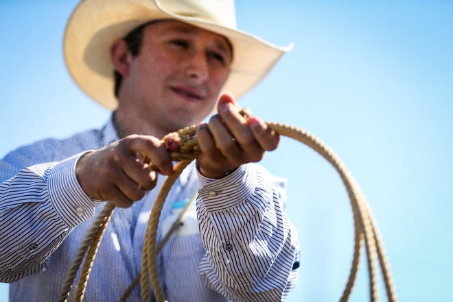 Ty Harris gets ready for calf roping during Cinch Roping Fiesta Saturday, Oct. 27, 2018, at the Outdoor Roping Arena.