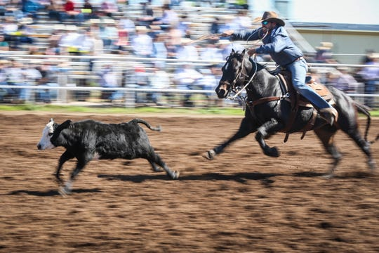 Cade Swor rides out after a calf during Cinch Roping Fiesta Saturday, Oct. 27, 2018, at the Outdoor Roping Arena.
