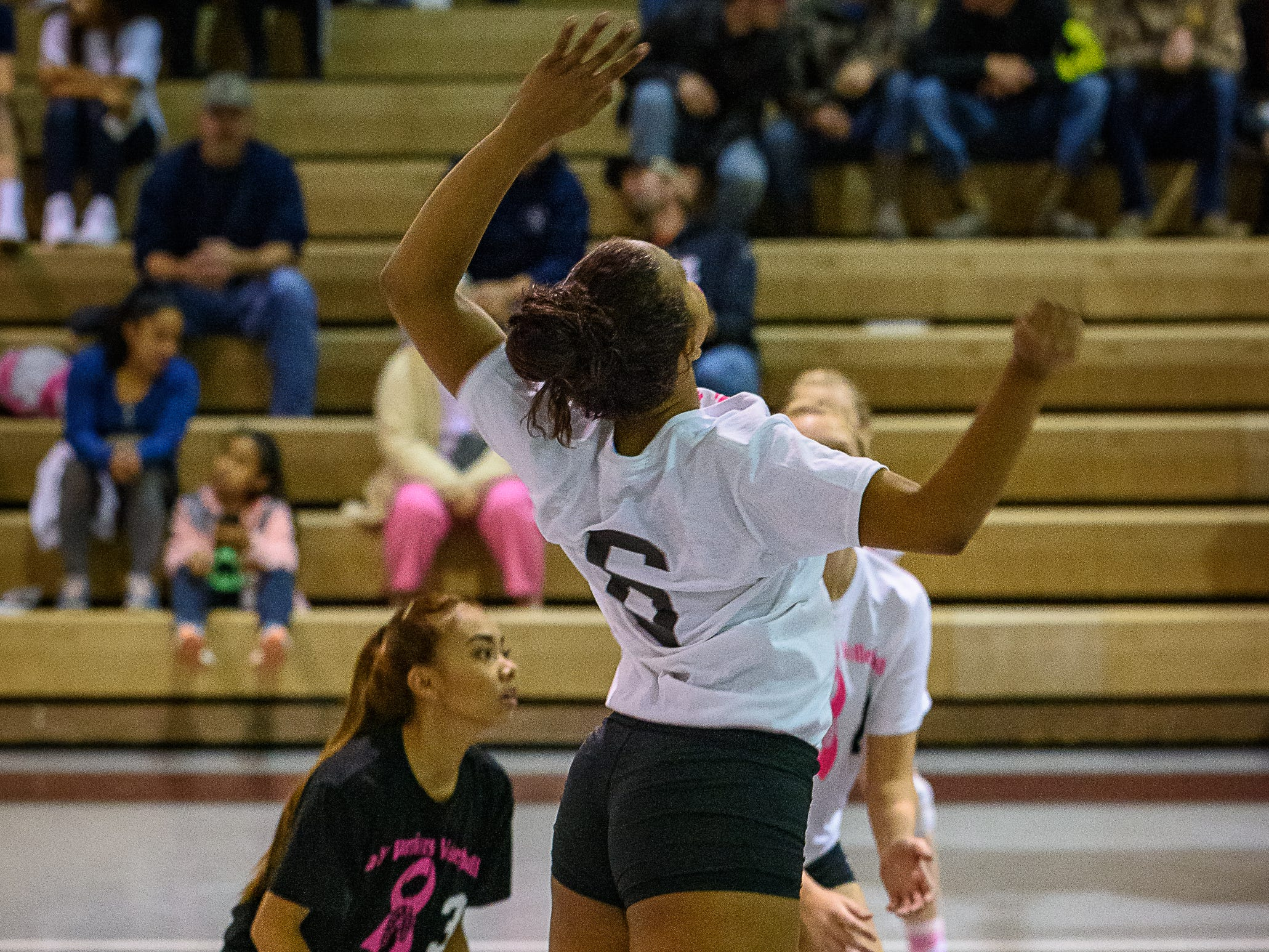 Nandua's Arianna Fletcher leaps for the ball during their varsity volleyball game at home against Chincoteague High School on Oct. 25, 2018.