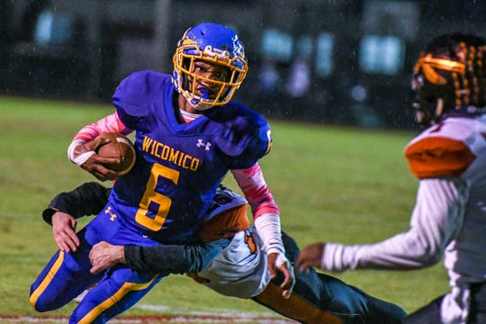 Wicomico High quarterback Ronnie Satchell (6) runs the ball against Easton High at the Wicomico County Stadium on Friday, Oct 26, 2018.