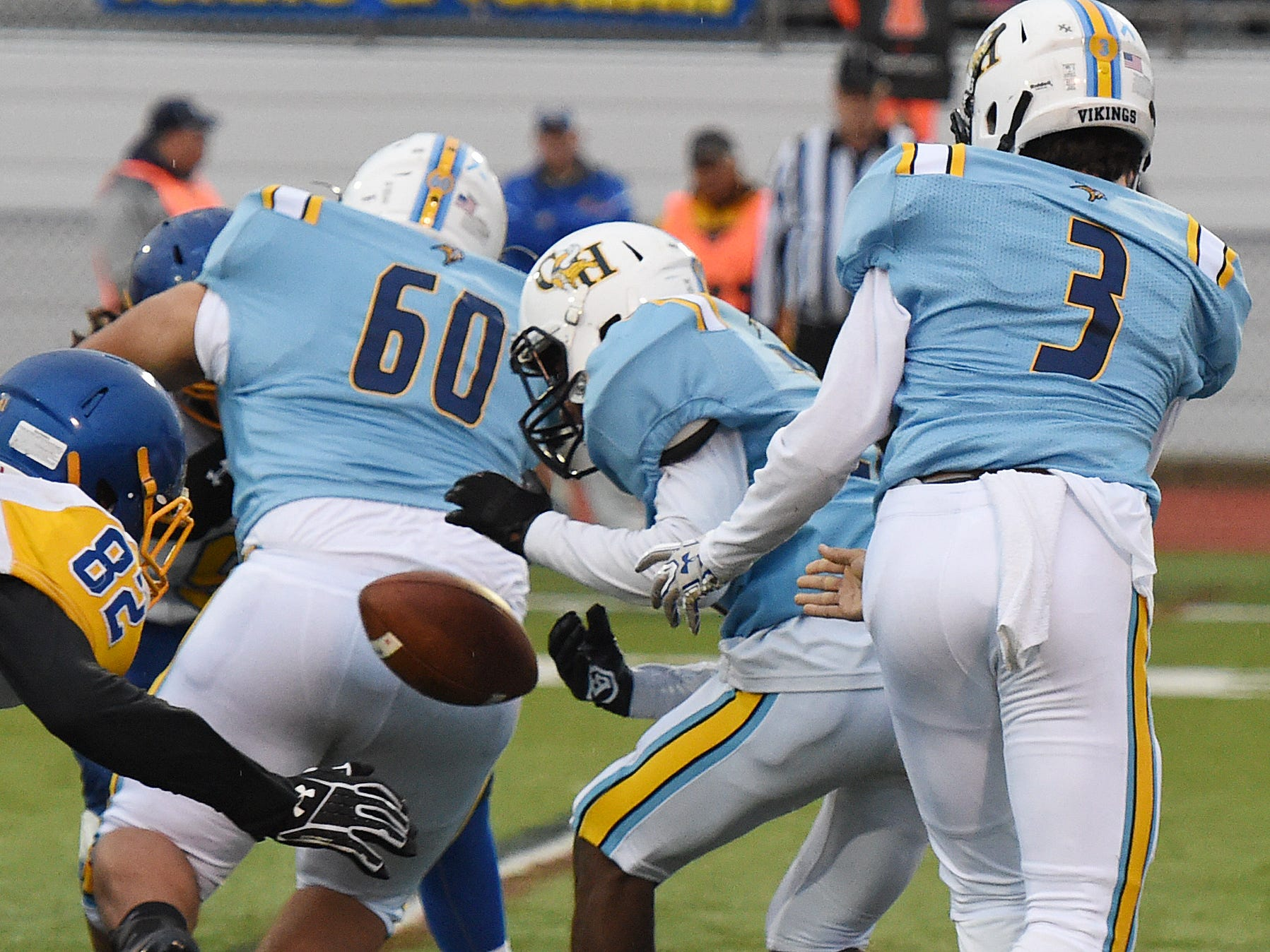 Cape's Kevin Williams fumbles a handoff from quarterback Samuel Jones in the game against  Sussex Central  Oct. 26, 2018.