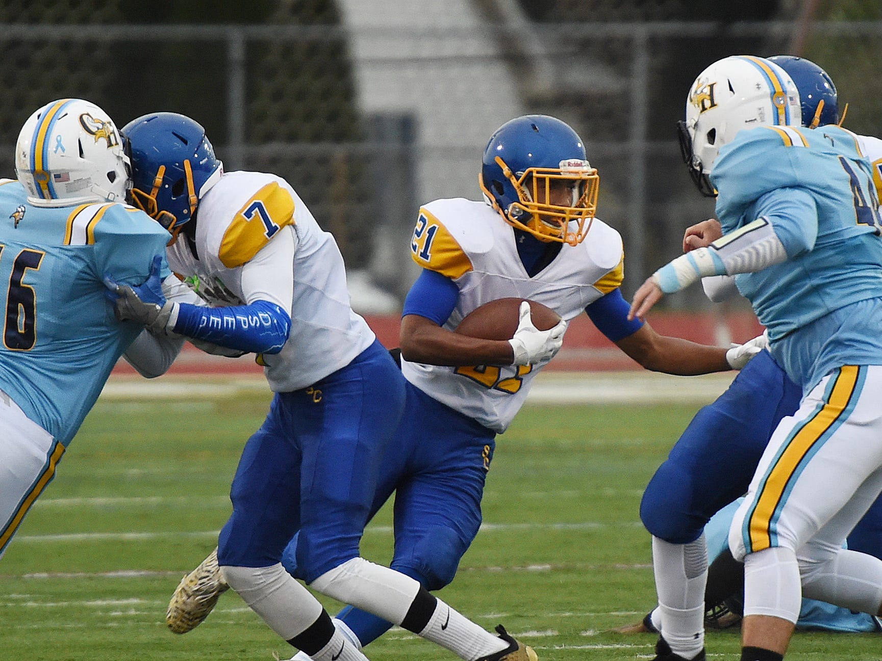 Sussex Central's Central's TyJhir Sheppard-Parker gains some yardage against Cape Henlopen during the game Oct. 26, 2018.