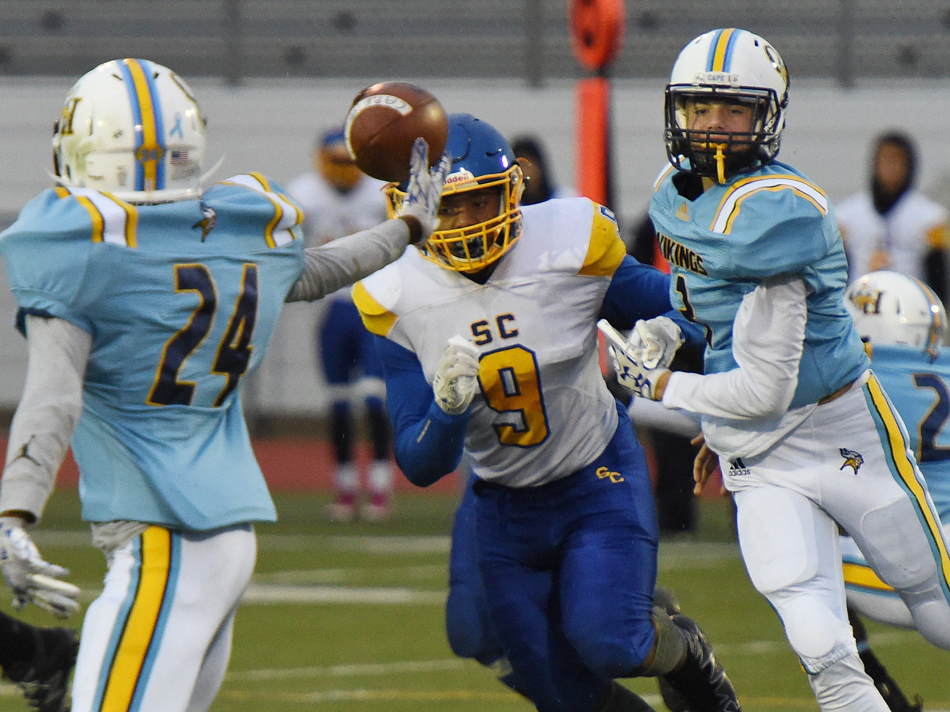 Cape's Samuel Jones, No. 3, tosses the ball to Davonte Johnson during the game Oct. 26, 2018.