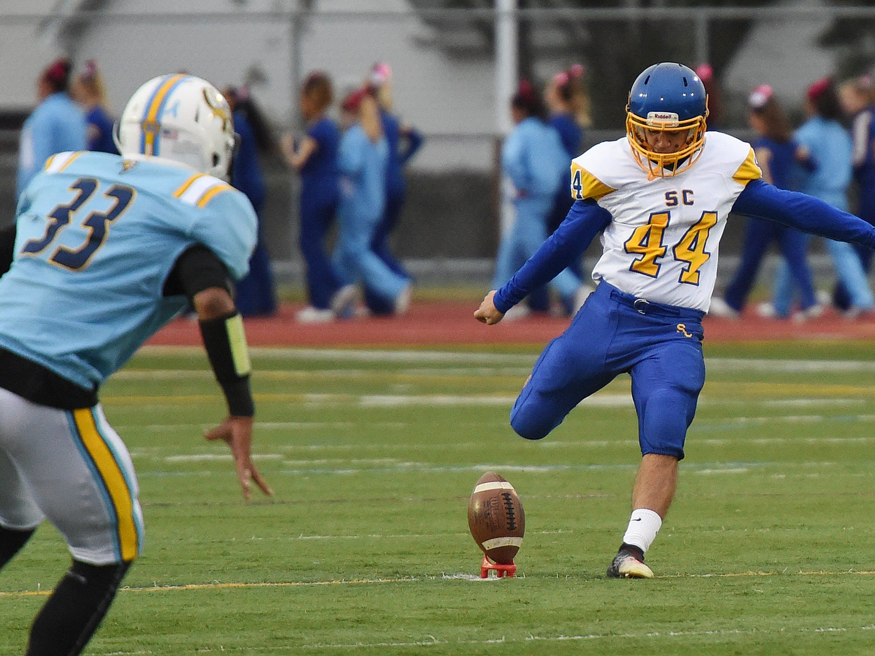 Sussex Central's Samern Sam kicks the ball during the game against  Cape Henlopen in Lewes on Oct. 26, 2018.