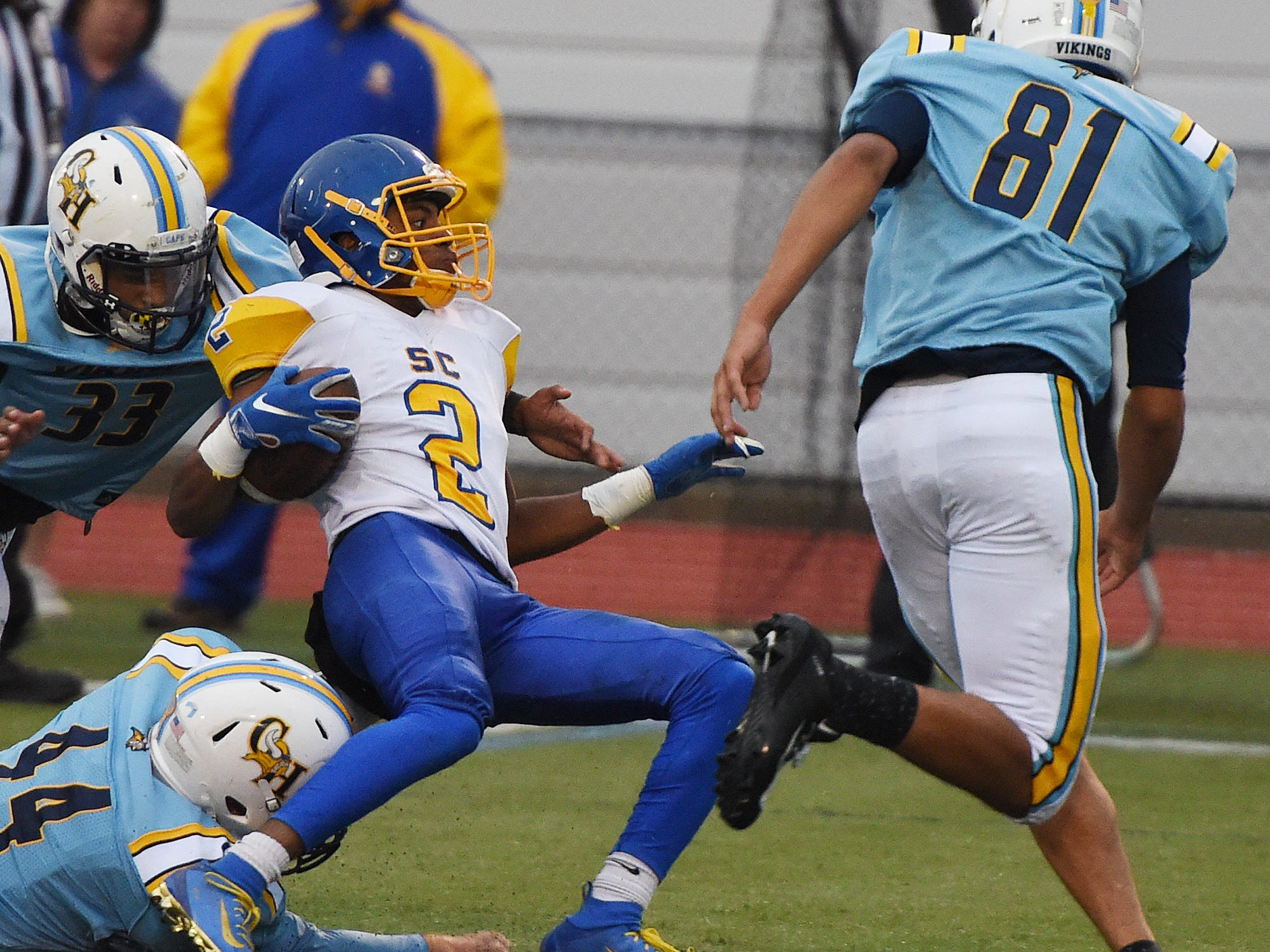 Sussex Central's Shihiem Williams gets brought down by Cape defenders  during their game Oct. 26, 2018.