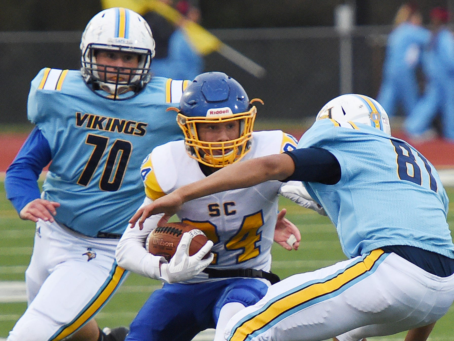 Sussex Central's Isaiah Barnes moves the ball as Cape's  Ben Weathersby, 81, attempts tackle during their game Oct. 26, 2018.