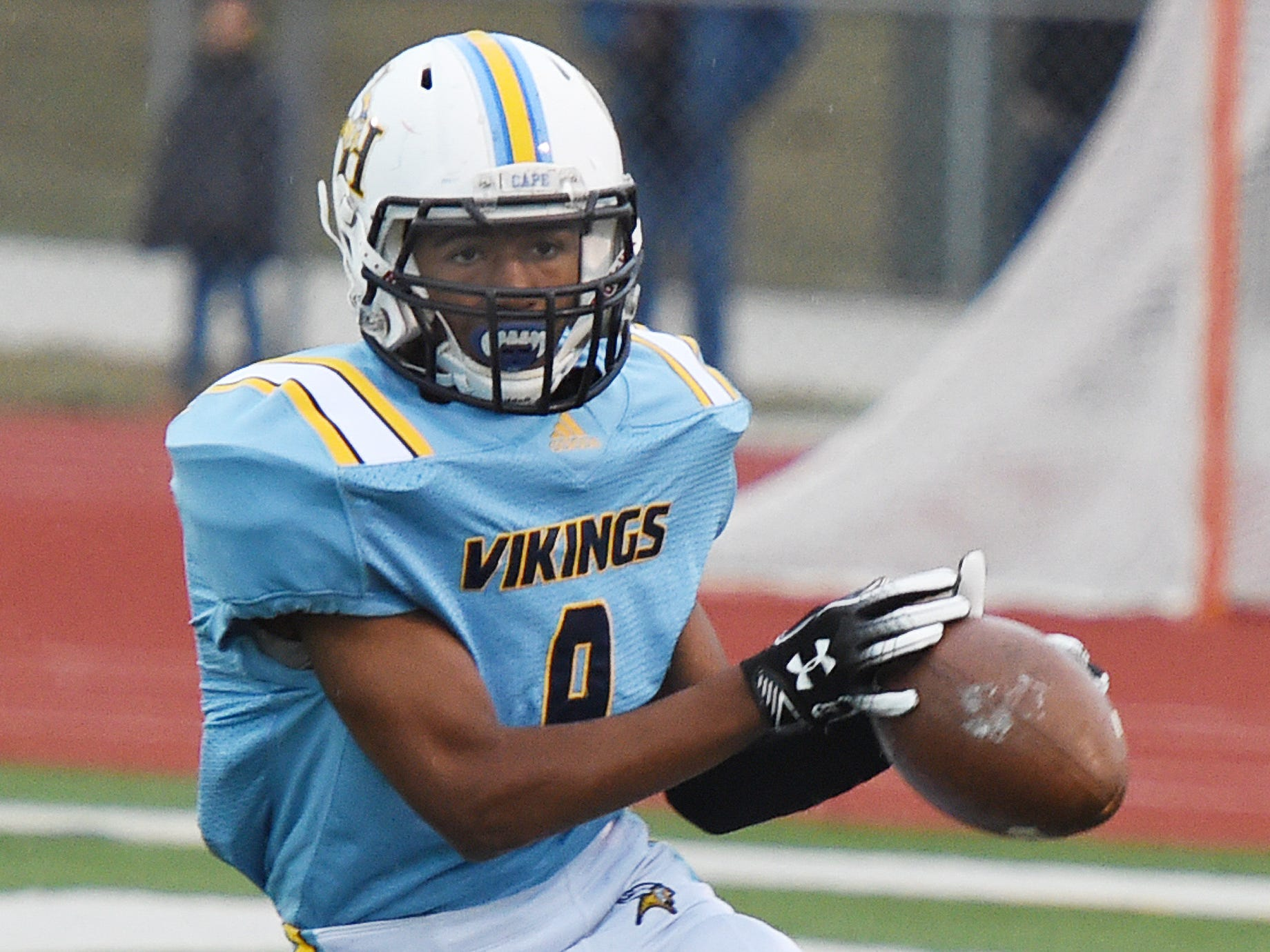 Cape Henlopen's Daniel Saez bobbles the ball during their varsity football game against Sussex Central at home Oct. 26, 2018, at  Legends Stadium near Lewes. Cape lost 43-0 to Sussex Central.