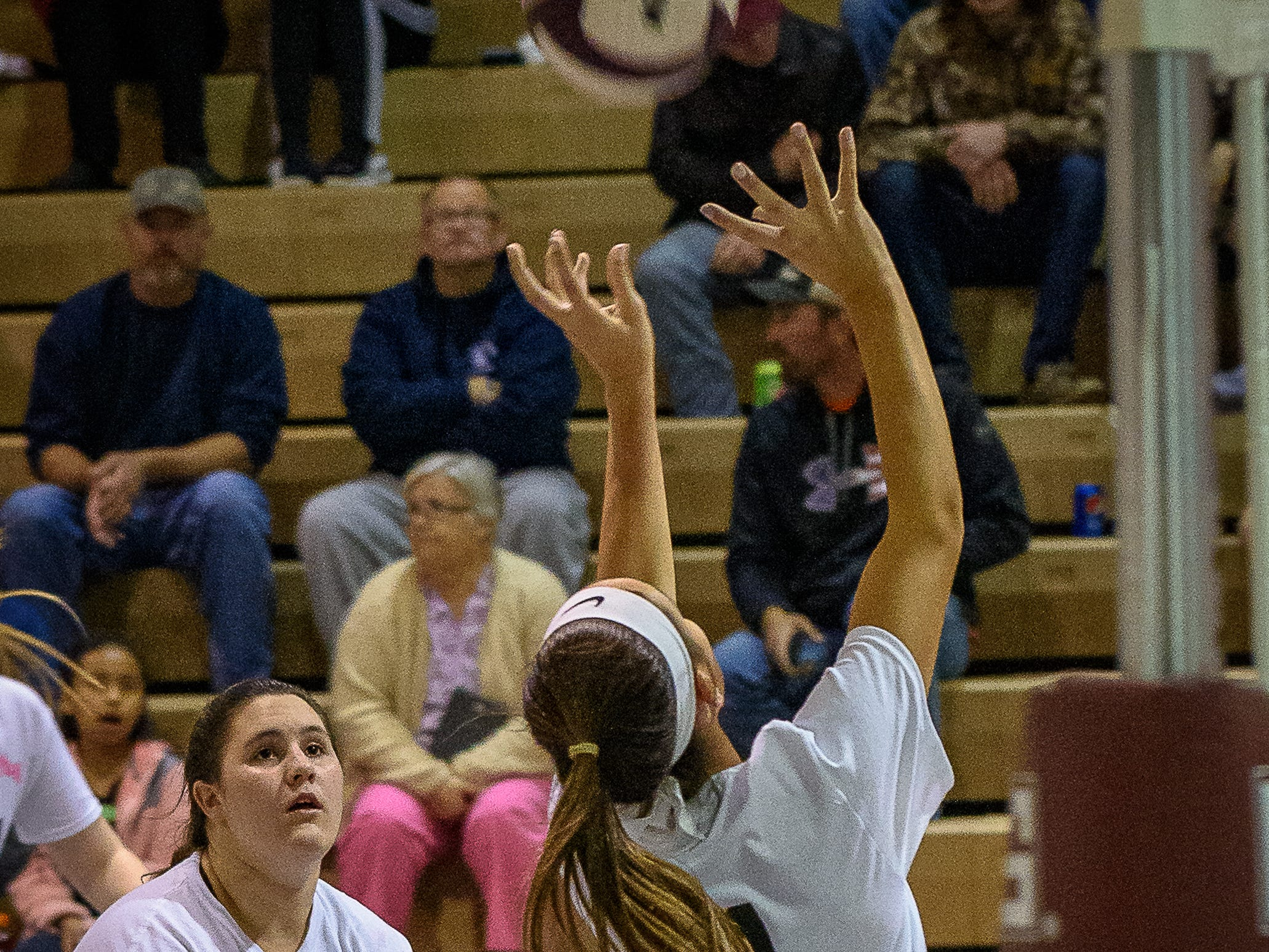 Nandua's Parker Murphy shoots during the game against Chincoteague on Oct. 25, 2018 as Jamie Wert watches.