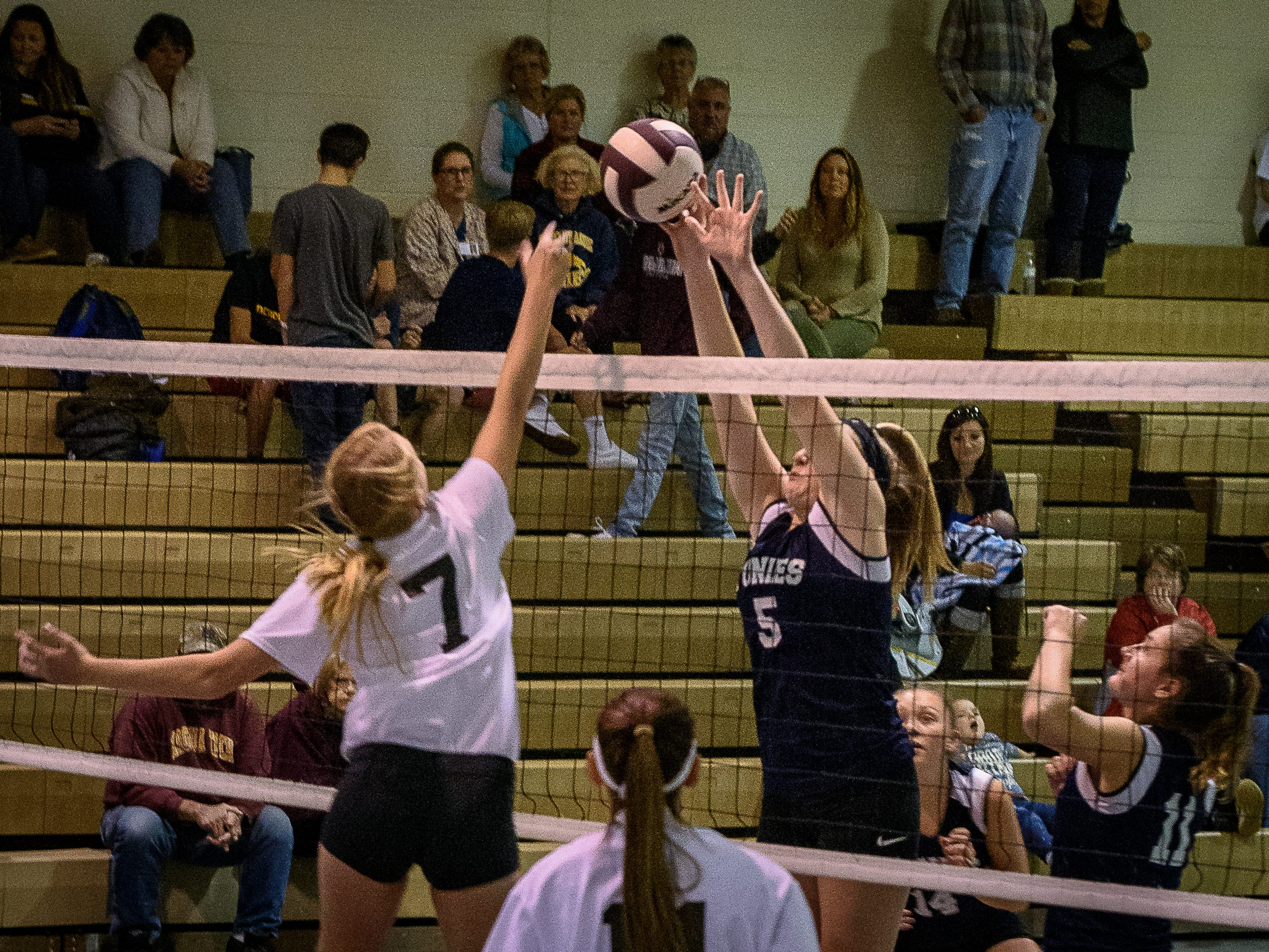 Chincoteague's Caroline Shelly and Nandua's Leah Truitt battle at the net during the game Oct. 25, 2018.