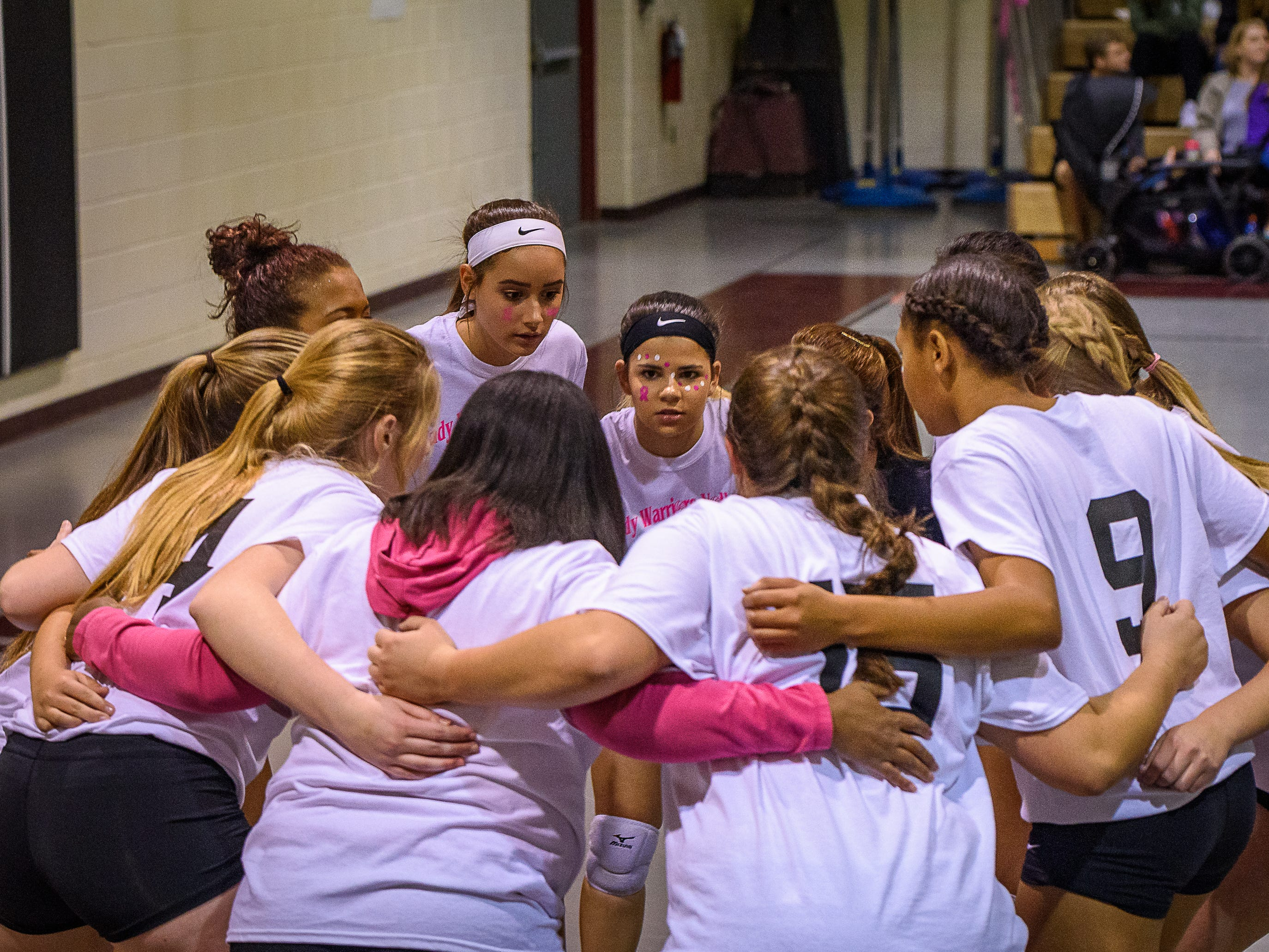 Nandua Warriors  huddle before the start of their game against Chincoteague on Oct. 25, 2018.