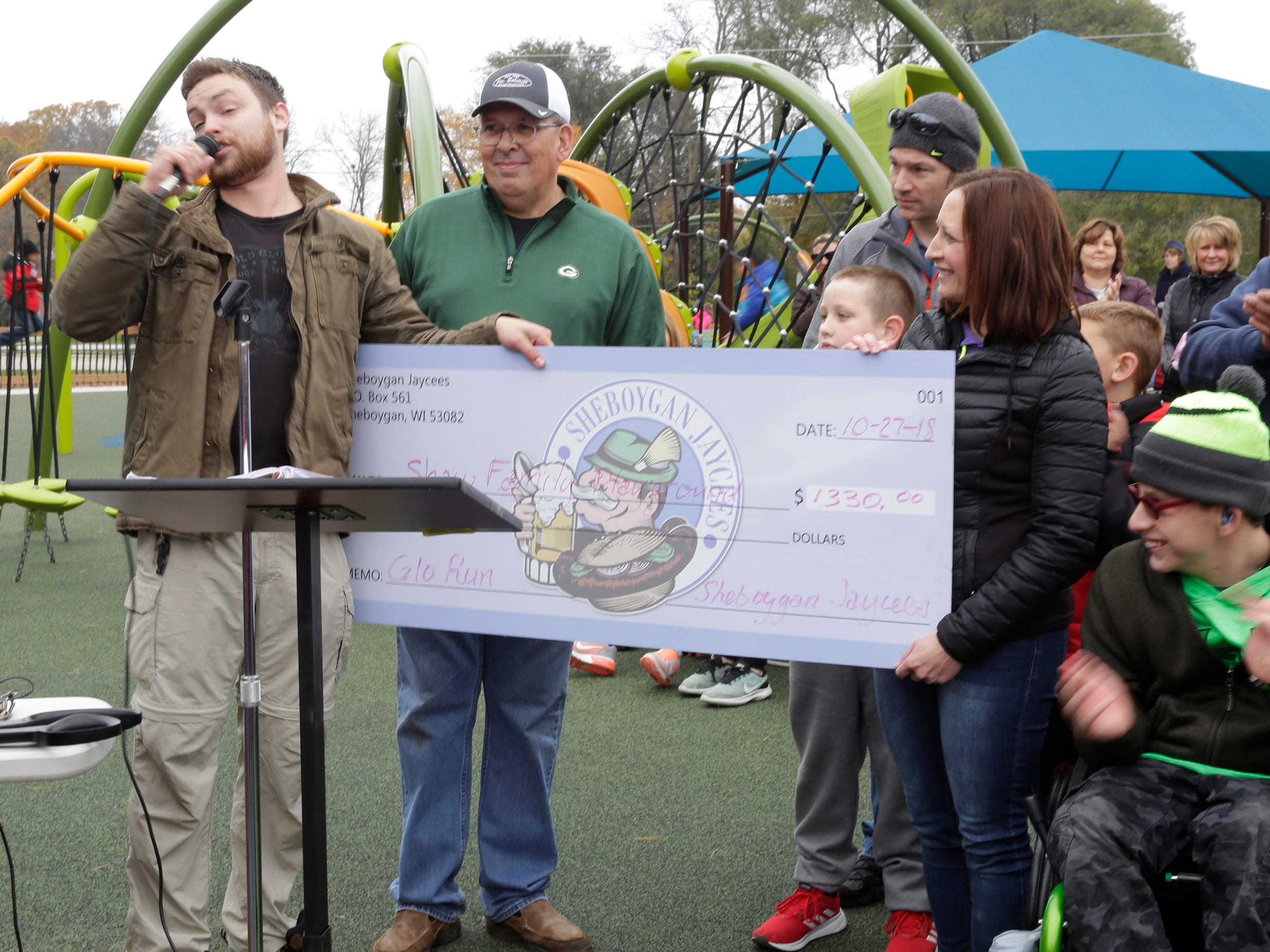 The Sheboygan Jaycees presented the last portion of the money they raised for the Shaw Family Playground, Saturday, September 27, 2018, in Sheboygan, Wis. The playground held a ribbon cutting event to showcase the adaptive playground that is accessible for children of all physical abilities.
