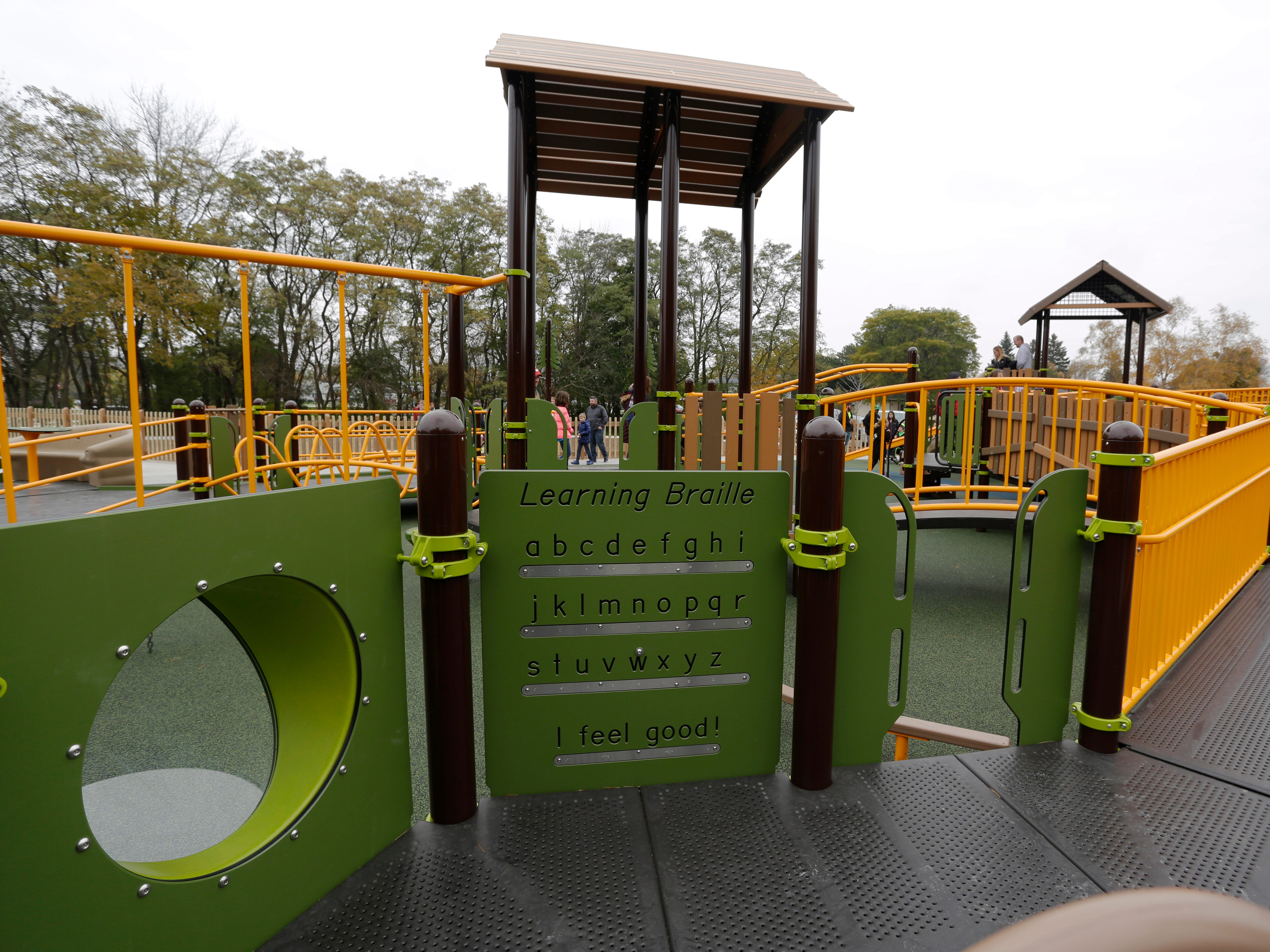 Some of the adaptive features at the Shaw Family Playground include braille, Saturday, September 27, 2018, in Sheboygan, Wis. The playground held a ribbon cutting event to showcase the adaptive playground that is accessible for children of all physical abilities.
