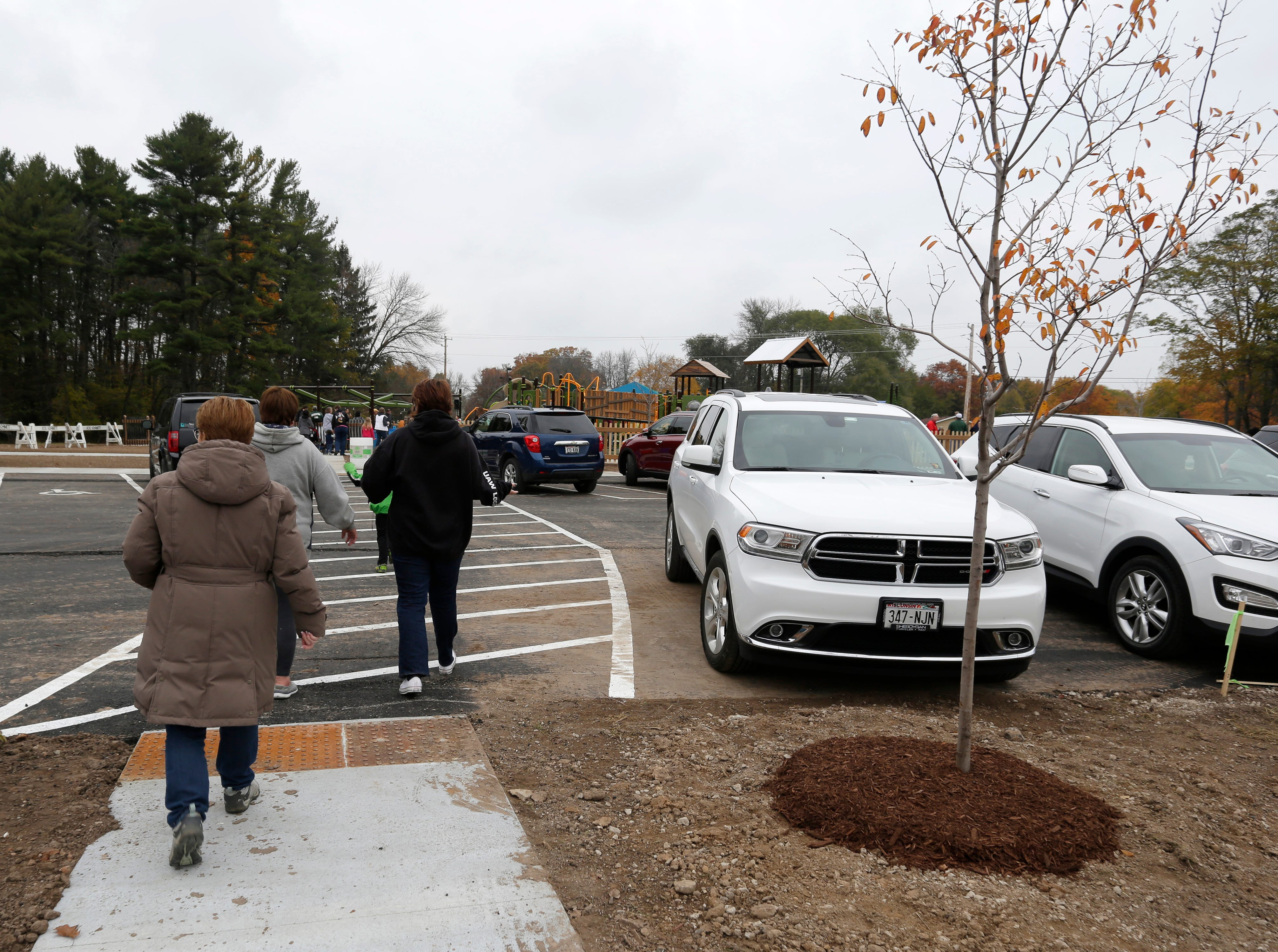 People arriving at the ribbon cutting for hte Shaw Family Playground saw freshly planted trees near the entrance, Saturday, September 27, 2018, in Sheboygan, Wis. The playground held a ribbon cutting event to showcase the adaptive playground that is accessible for children of all physical abilities.
