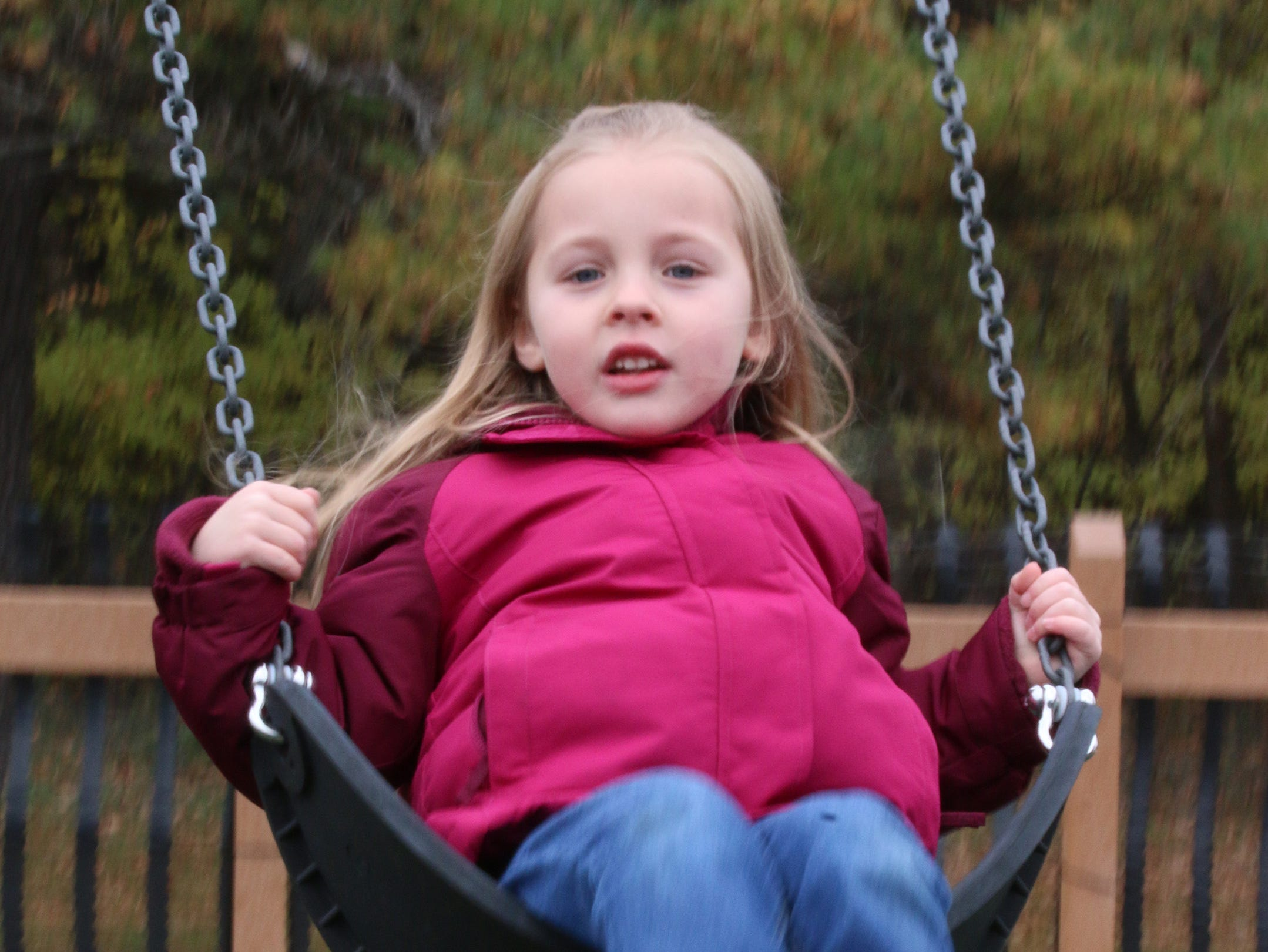 Audrey Wiltzius, 5, of Sheboygan, tests out a swing at the Shaw Family Playground, Saturday, September 27, 2018, in Sheboygan, Wis. The playground held a ribbon cutting event to showcase the adaptive playground that is accessible for children of all physical abilities.
