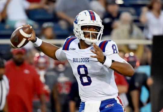 Louisiana Tech Bulldogs quarterback J'Mar Smith (8) throws a pass against the Florida Atlantic Owls during the first half at FAU Football Stadium.