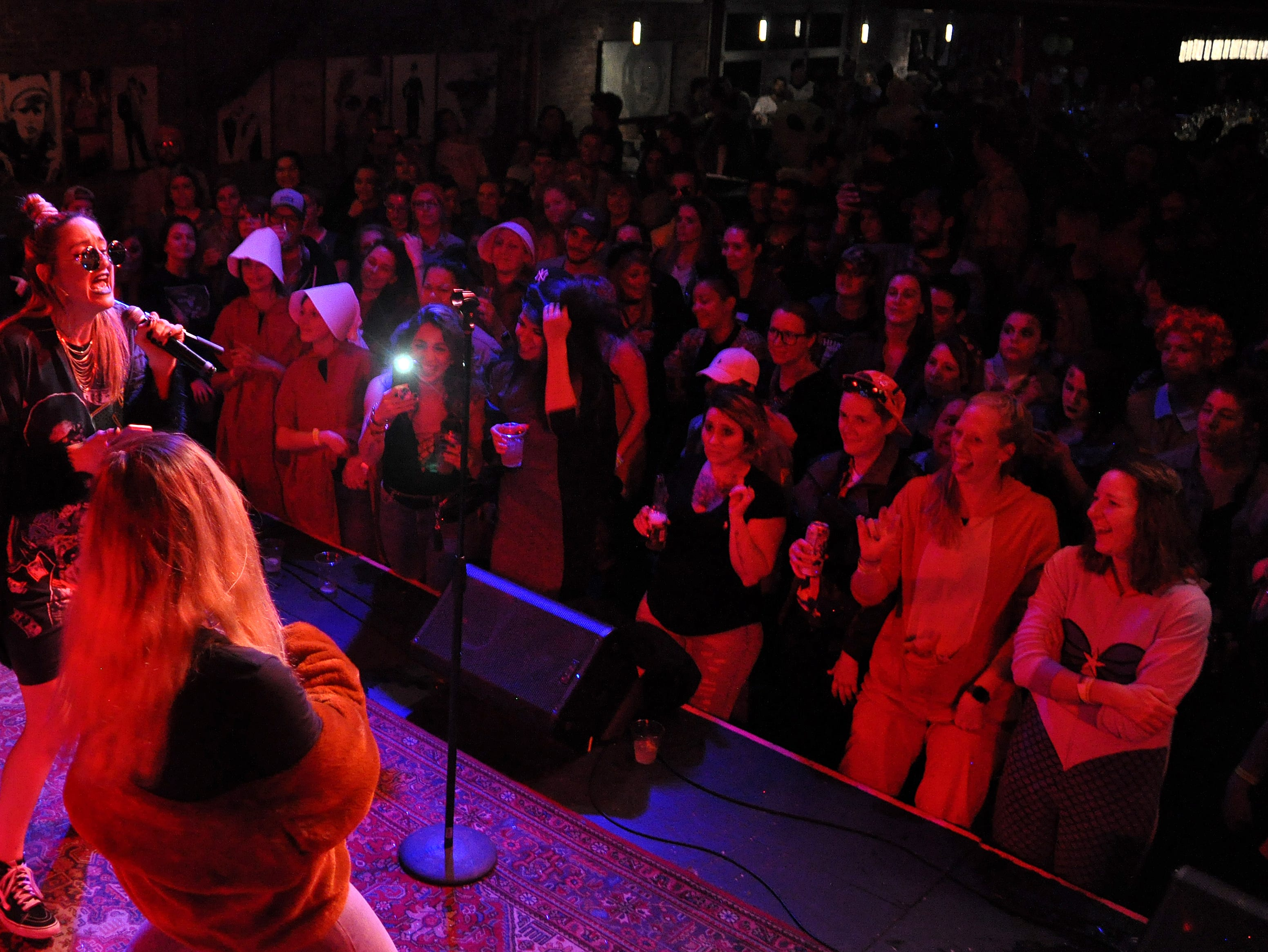 Taylor Weiland, left, and Allyson Fordyce perform at the 10th Annual Halloween Rap Karaoke show at Icon Lounge Friday night. The event is was created by the Sioux Falls band Soulcrate.
