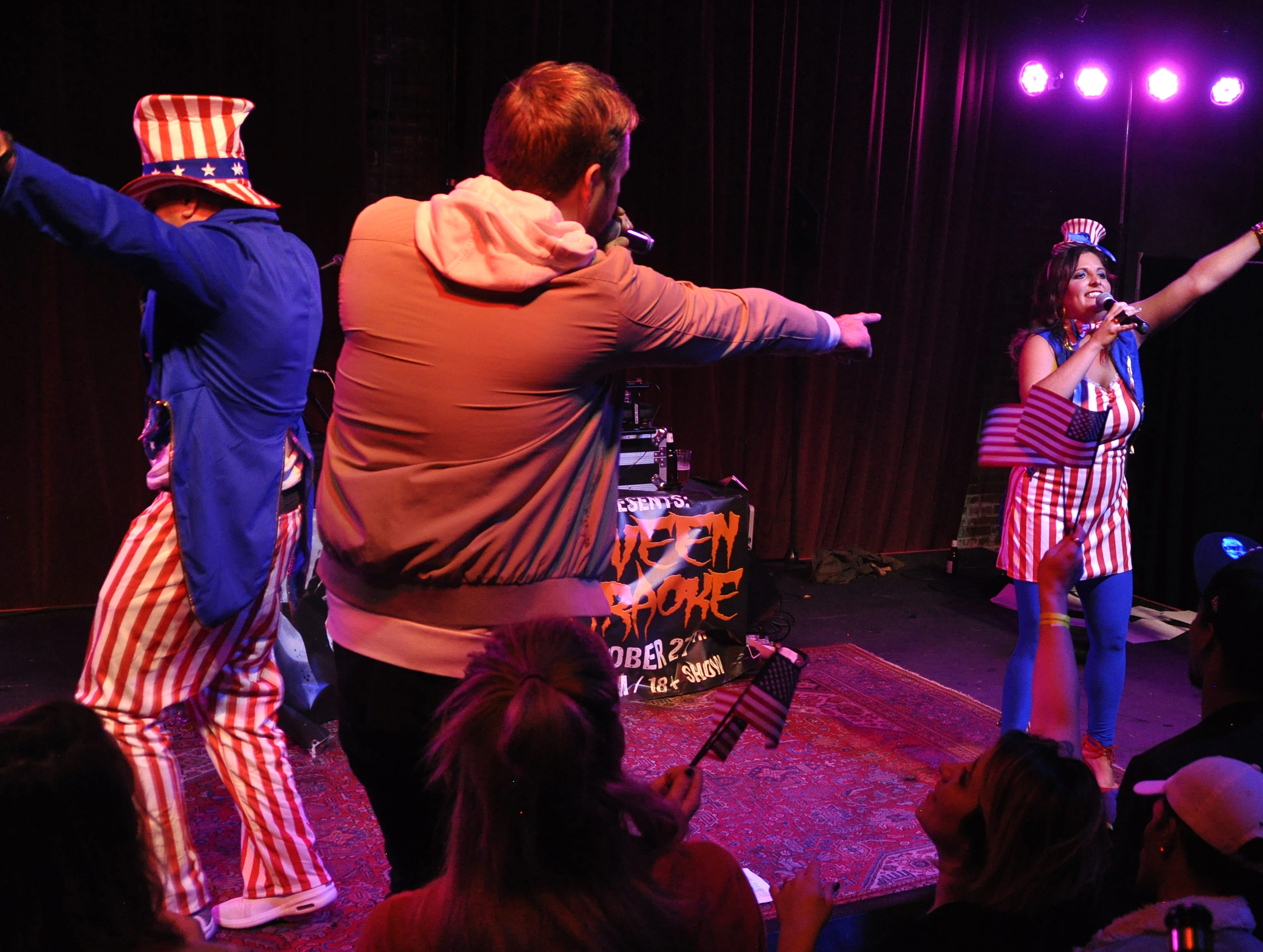 Elizabeth Hunstad and Matt Kuiper, far left, perform with Danny, left, and Wes Eisenhauer at the 10th Annual Halloween Rap Karaoke show at Icon Lounge Friday night. The event is was created by the Sioux Falls band Soulcrate.