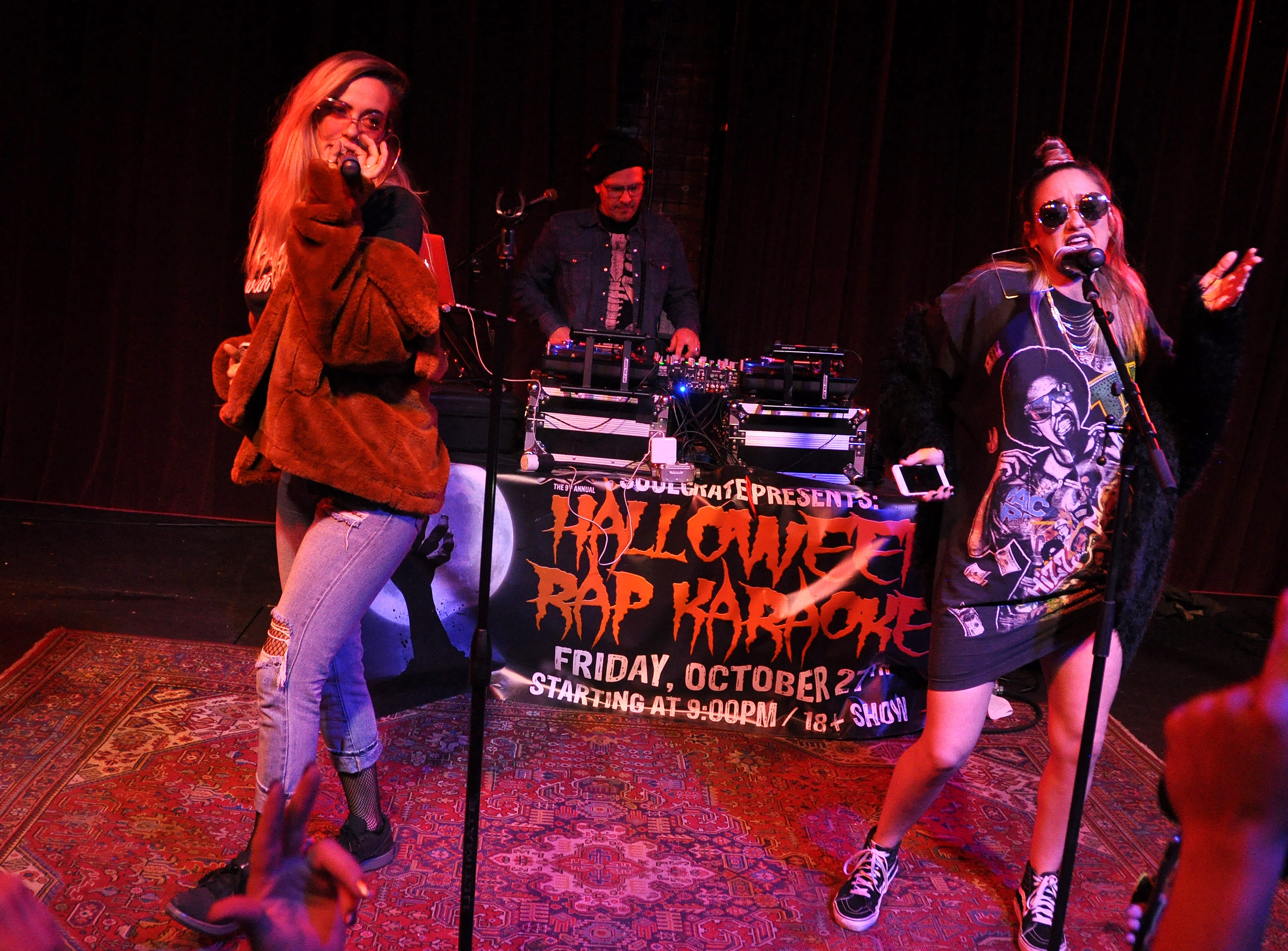 Taylor Weiland, right, and Allyson Fordyce perform at the 10th Annual Halloween Rap Karaoke show at Icon Lounge Friday night. The event is was created by the Sioux Falls band Soulcrate.