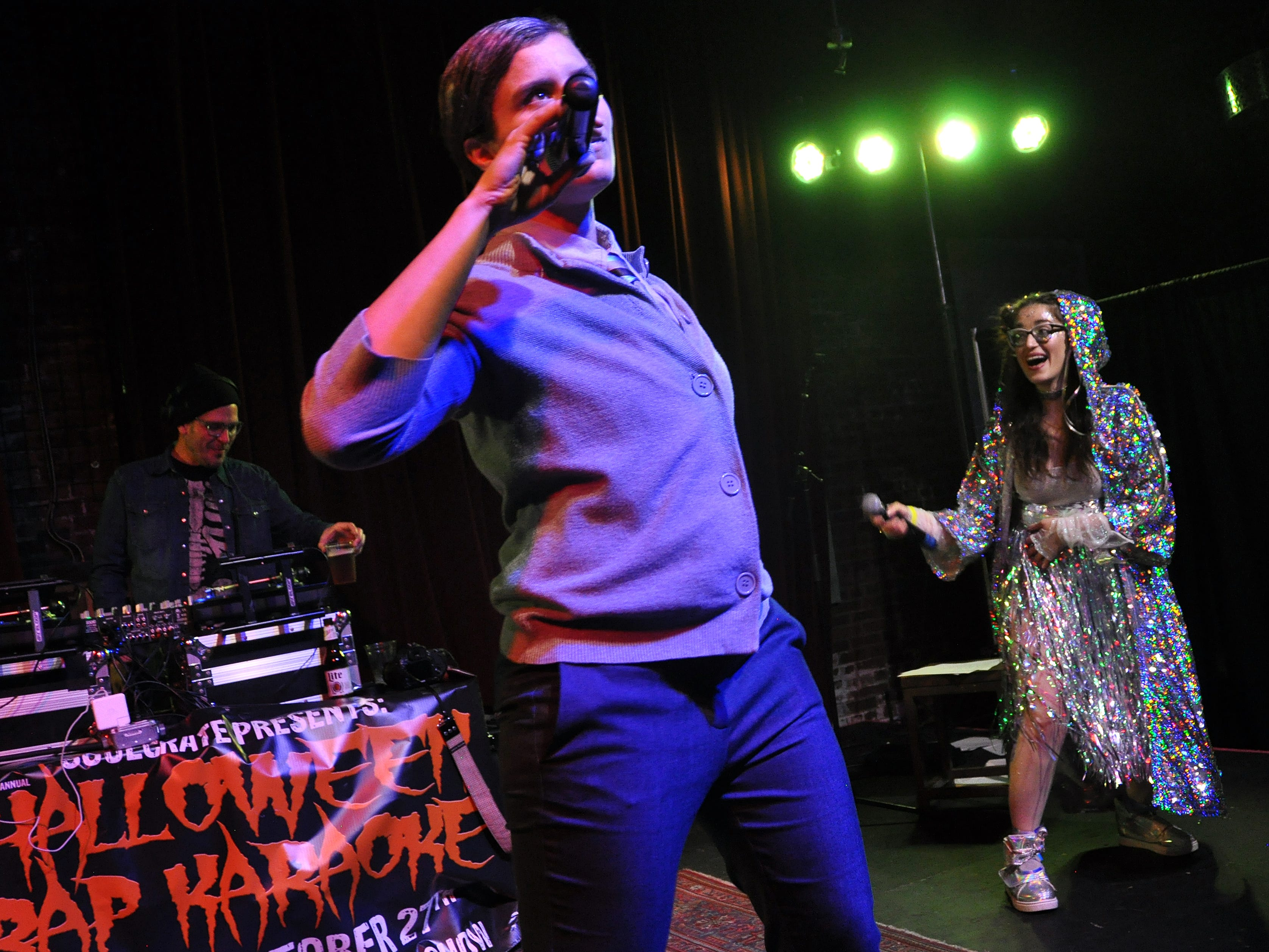 Mary Campbell, left, and Catherine Holland perform during the 10th Annual Halloween Rap Karaoke show at Icon Lounge Friday night. The event is was created by the Sioux Falls band Soulcrate.