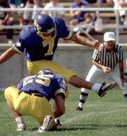 Adam Vinatieri attempts a field goal for South Dakota State.