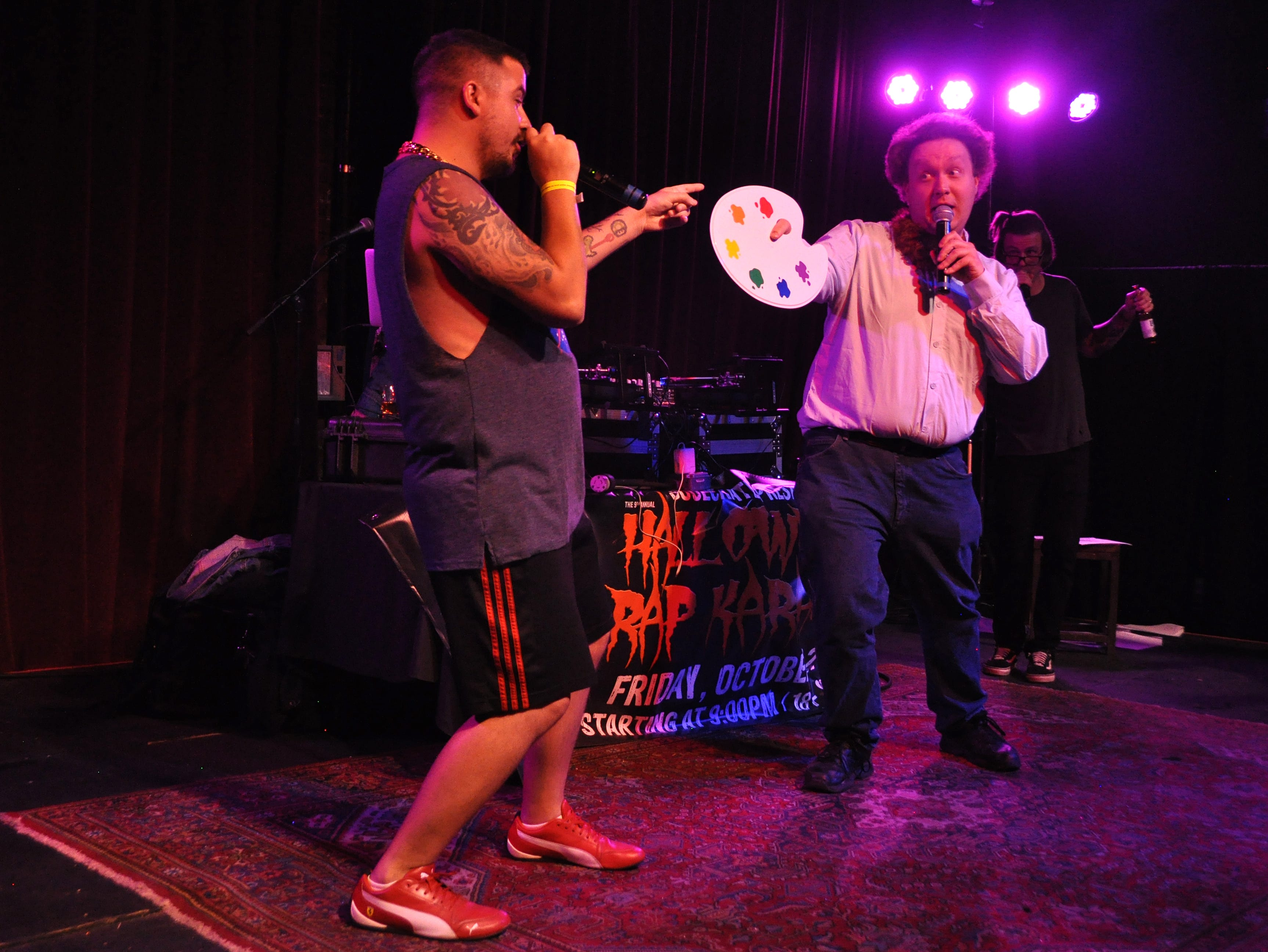 Zach Dresch, right, and Garrett Rahn perform at the 10th Annual Halloween Rap Karaoke show at Icon Lounge Friday night. The event is was created by the Sioux Falls band Soulcrate.