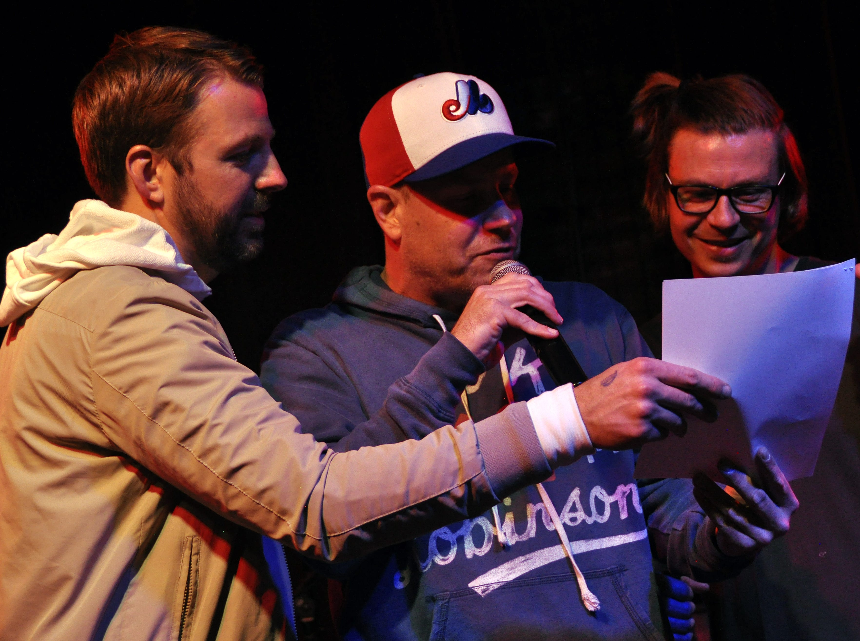 Chuck Beck, center, works through Public Enemy's 'Fight the Power' with Wes, right, and Danny Eisenhauer during the 10th Annual Halloween Rap Karaoke show at Icon Lounge Friday night. The event is was created by the Sioux Falls band Soulcrate.