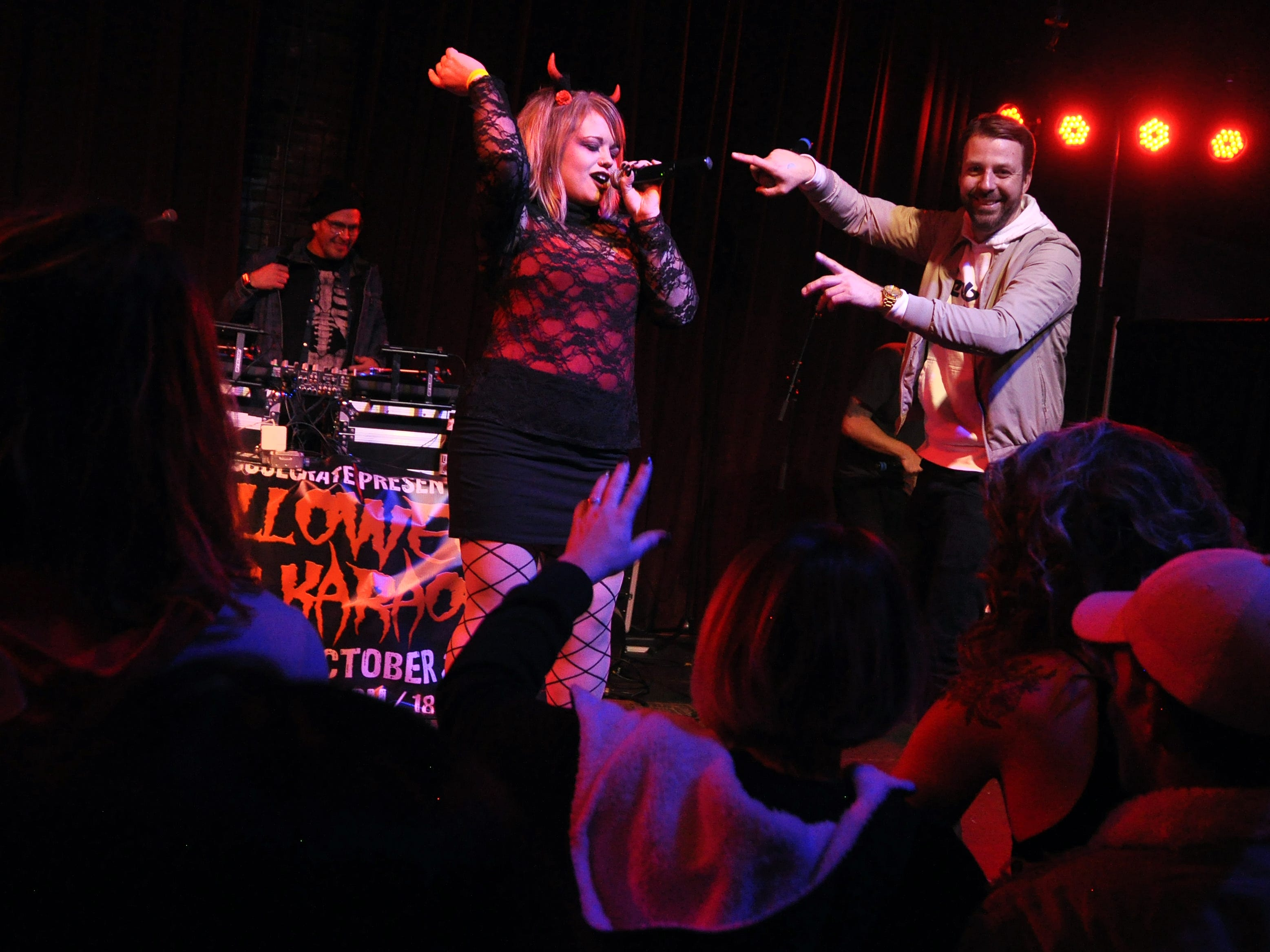 Savannah Holloman gets some encouragement from Danny Eisenhauer during her performance at the 10th Annual Halloween Rap Karaoke show at Icon Lounge Friday night. The event is was created by the Sioux Falls band Soulcrate.