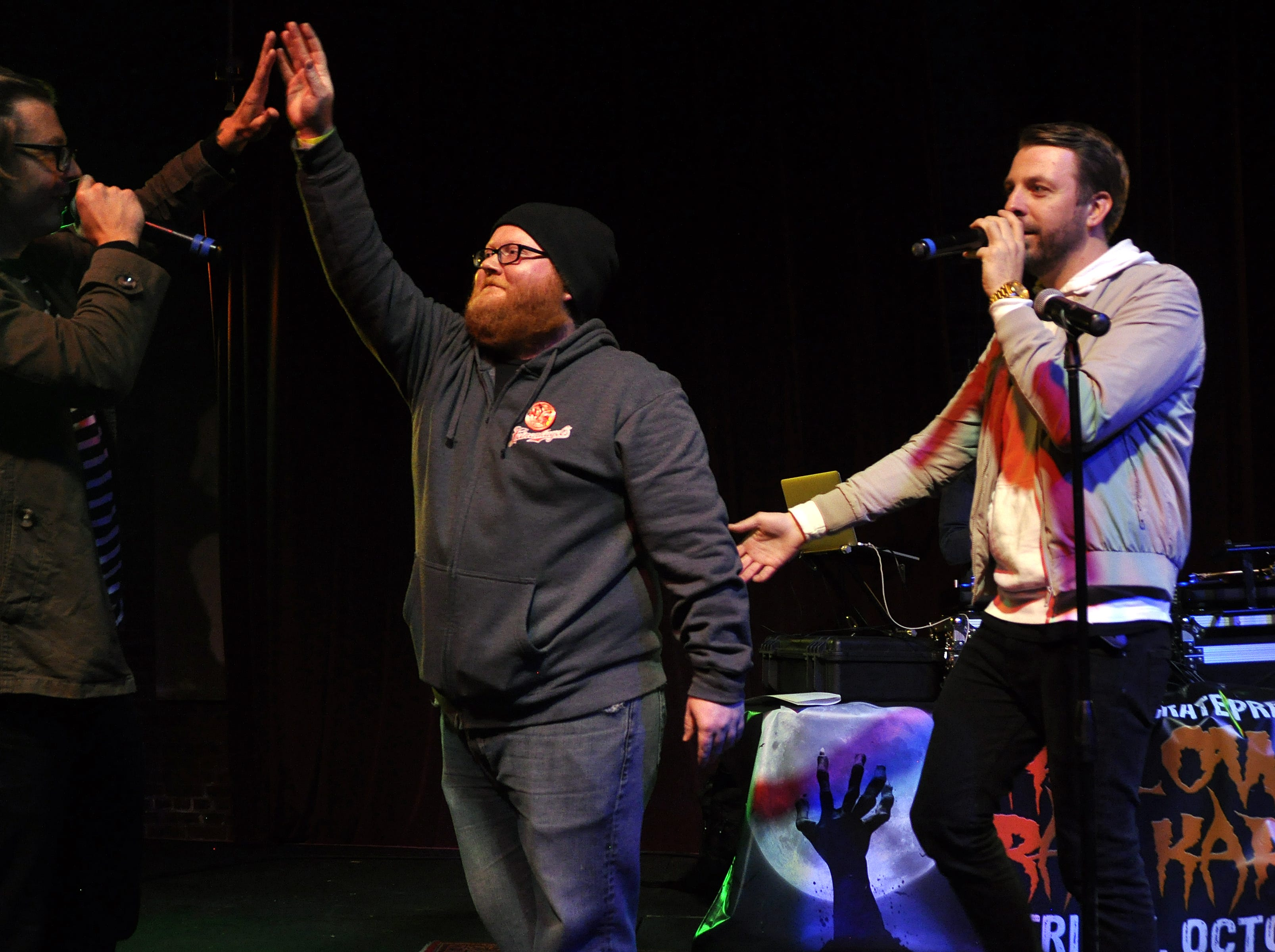 Tom Ottoson, center, kicked off the 10th Annual Halloween Rap Karaoke show at Icon Lounge Friday night. The event is was created by the Sioux Falls band Soulcrate.