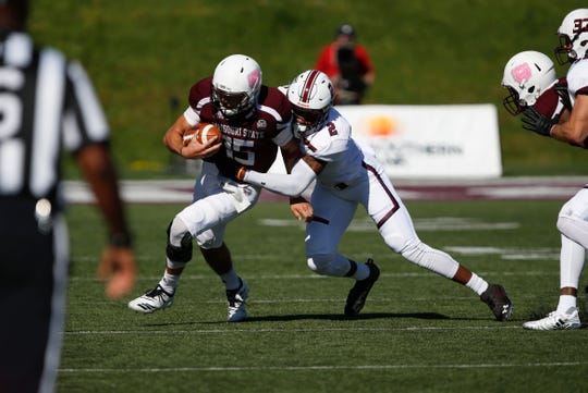 Missouri State quarterback Peyton Huslig gets tackled by Southern Illinois Saluki Jeremy Chinn during a game at Plaster Field on Saturday, Oct. 27, 2018.