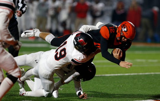 Republic junior Lucas Hayes dives into the end zone for a touchdown as Branson's Colton Vanderlaan attempts to stop him during a game at Republic on Friday, Oct. 26, 2018.