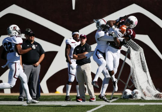 Missouri State's Lorenzo Thomas makes  a catch as Southern Illinois Saluki Terrance Henley attempts to break up the play during a game at Plaster Field on Saturday, Oct. 27, 2018.