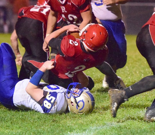 Riverheads' Devin Morris is tackled by Central-Woodstock's Zachary Helmick in the second quarter of their nondistrict football game on Friday, Oct. 26, 2018, at Riverheads High School in Greenville, Va.