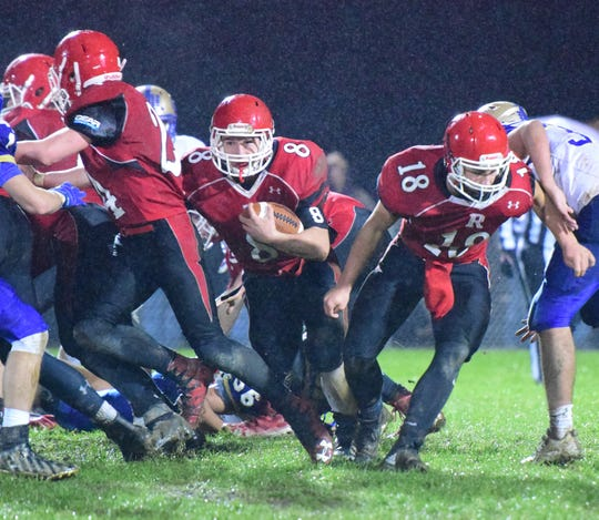Riverheads' Zac Smiley follows quarterback Justin McWhorter through the line during the second quarter of the Gladiators' nondistrict football game against Central-Woodstock on Friday, Oct. 26, 2018, at Riverheads High School in Greenville, Va.