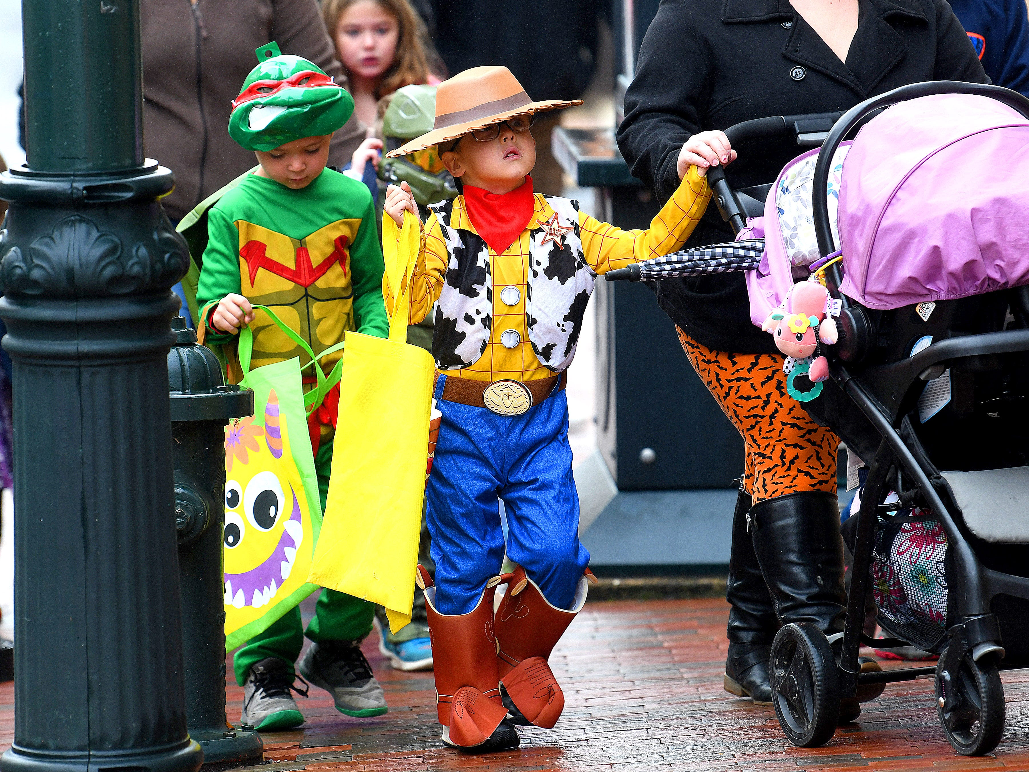 Sheriff Woody of Toy Story trick-or-treats in downtown Staunton on Saturday, Oct. 27, 2018.