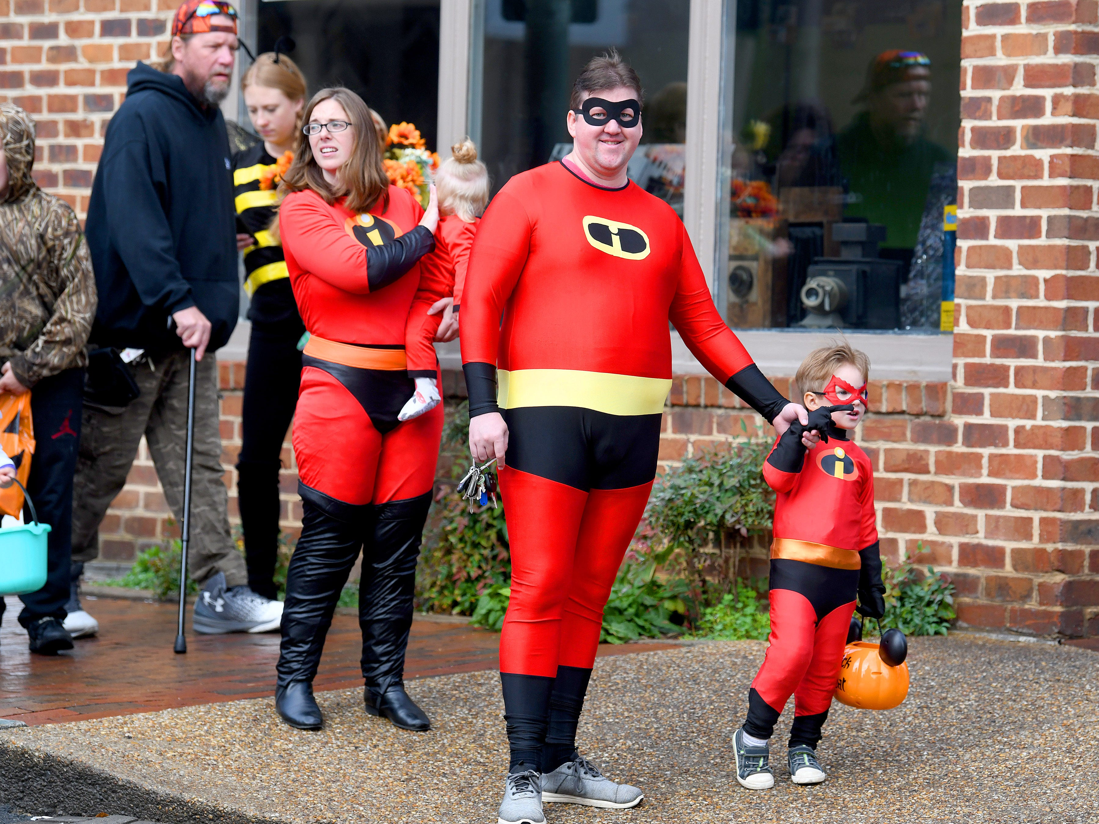 The Incredibles trick-or-treat as a family together in downtown Staunton on Saturday, Oct. 27, 2018.